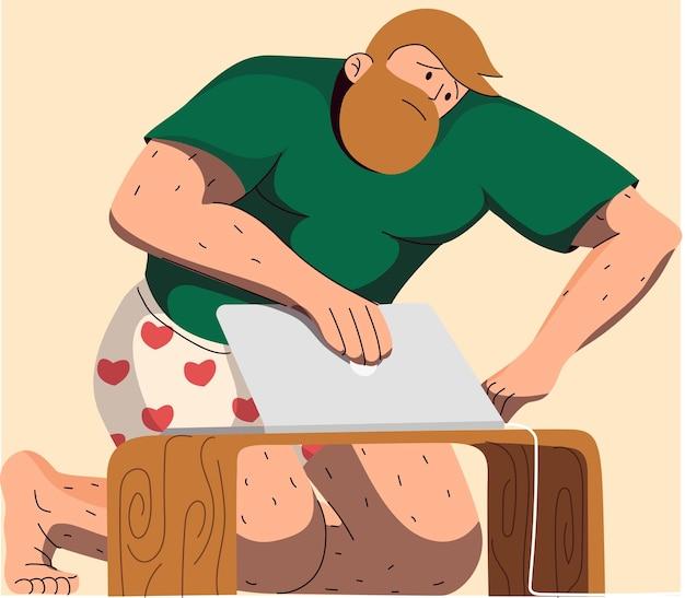 Homme en sous-vêtements utilisant un ordinateur portable