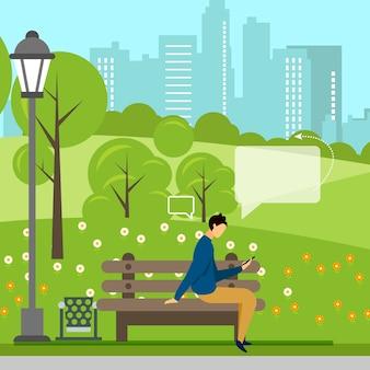 Homme avec téléphone, négociations en ligne dans un parc