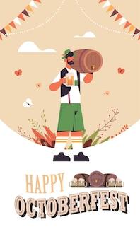 Homme tenant un baril et une tasse fête de la bière oktoberfest