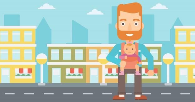 Homme tenant un bébé en écharpe.