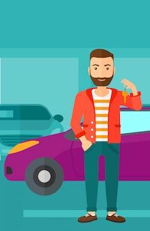 Homme tenant les clés d'une voiture neuve
