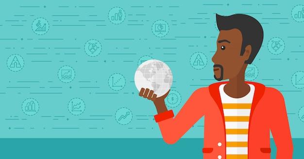 Homme tenant un globe.