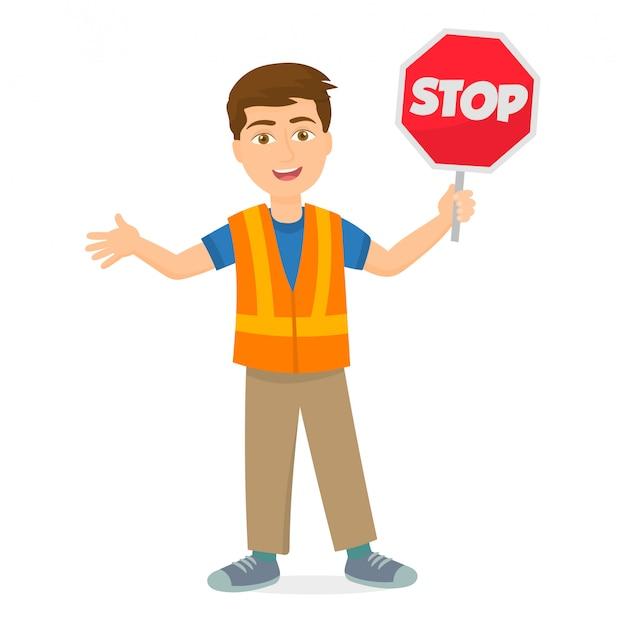 Homme tenant un panneau d'arrêt