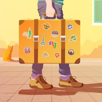 Un homme tenant une vieille valise. bagages du voyageur