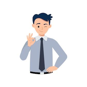 Homme en tenue d'affaires montrant le geste de la main ok comme symbole d'accord ou de succès.
