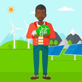 Homme, tenue, ampoule, à, éoliennes, intérieur