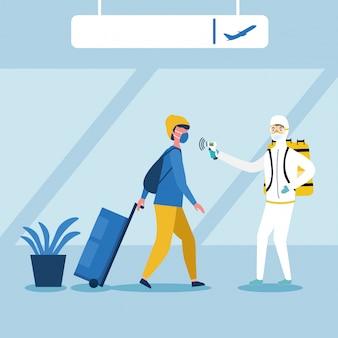 Homme, à, tenue protectrice, vérification, température homme, à, aéroport