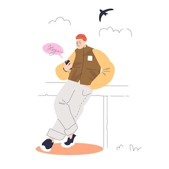 Homme textos à l'aide de smartphone à l'extérieur