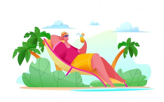 Homme touriste joyeux est allongé sur la plage par la bannière de la mer