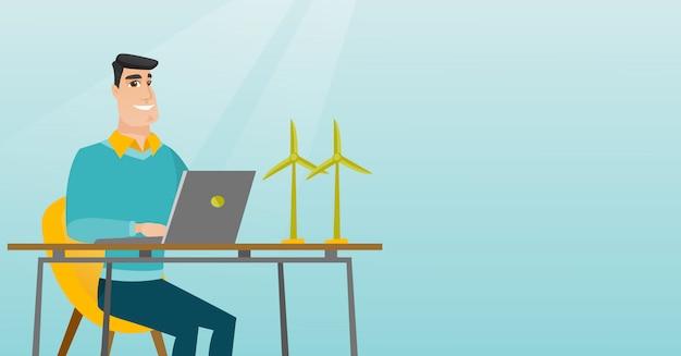 Homme travaillant avec le modèle d'éoliennes.