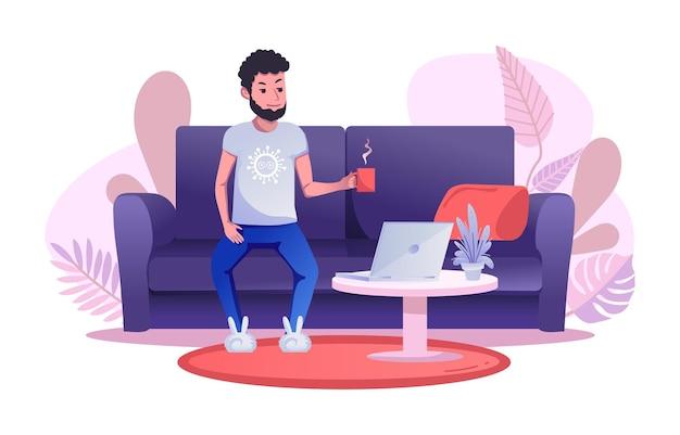 Un homme travaille à distance, assis sur le canapé et buvant une tasse de thé ou de café.