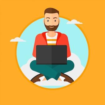 Homme utilisant la technologie de cloud computing.