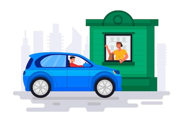L'homme va à une fenêtre au volant pour obtenir de la nourriture