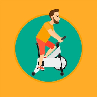 Homme, vélo stationnaire
