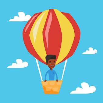 Homme volant dans l'illustration de montgolfière.