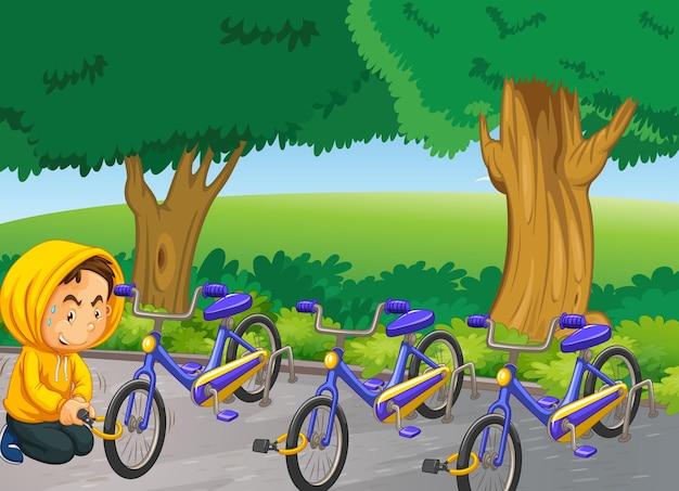 Homme volant du vélo dans le parc