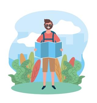 Homme de voyage portant des lunettes de soleil avec carte globale et sac à dos