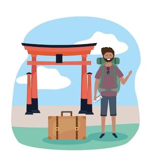Homme de voyage avec sac à dos et destination de sculpture tokyo