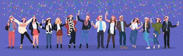 Hommes d'affaires en chapeaux de père noël ayant des confettis fête d'entreprise gens d'affaires célébrant joyeux noël bonne année vacances d'hiver