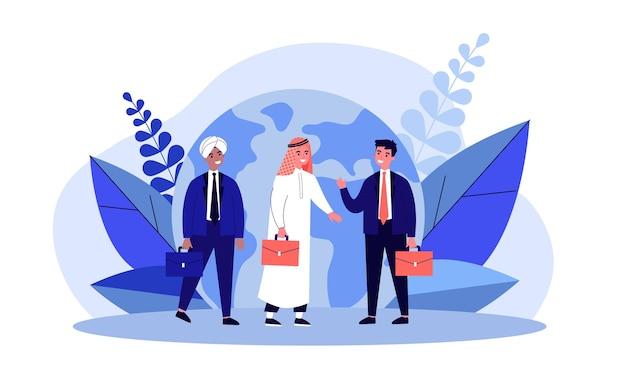 Hommes d'affaires indiens arabes et européens devant le globe