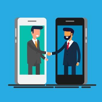 Hommes d'affaires se serrant la main à travers l'écran du téléphone intelligent.