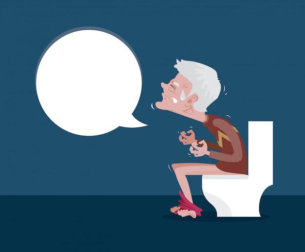 Les hommes assis sur les toilettes et la constipation