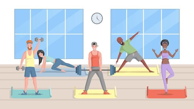 Hommes et femmes souriants en vêtements de sport faisant de l'exercice dans