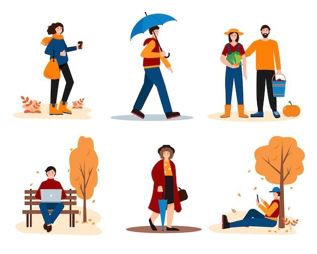 Hommes et femmes vêtus de vêtements lumineux marchant dans un parc travaillant en plein air ou récoltant en automne