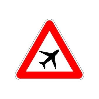 Icône d'avion sur le panneau de signalisation triangulaire rouge et blanc sur blanc