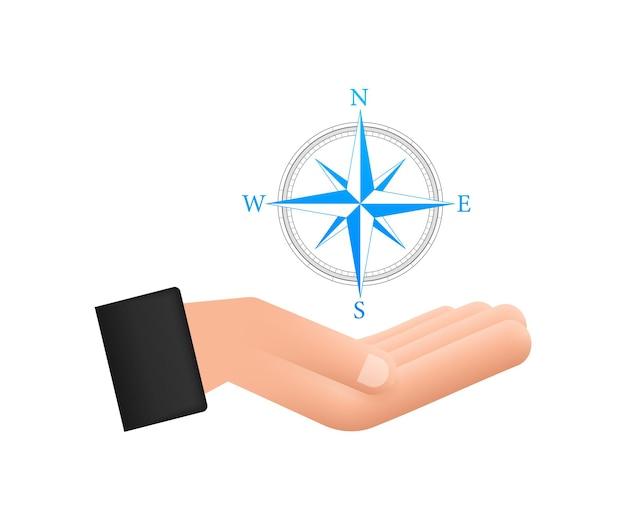 Icône de boussole sur les mains sur fond blanc symbole de navigation vecteur plat