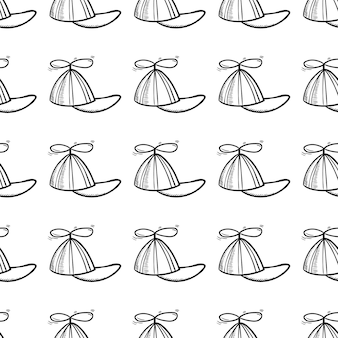 Icône de doodle de casquette enfant modèle sans couture dessinée à la main. croquis noir dessiné à la main. signe symbole de dessin animé. élément de décoration. fond blanc. isolé. conception plate. illustration vectorielle.