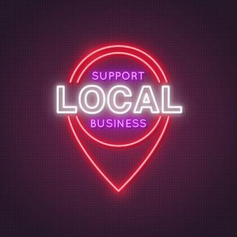 L'icône d'emplacement au néon avec les mots prend en charge les entreprises locales.