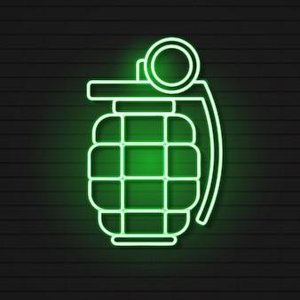 Icône de grenade à main néon rougeoyant isolé sur fond de mur de brique. explosion d'une bombe.