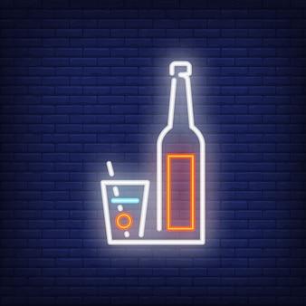Icône néon de verre à cocktail et bouteille