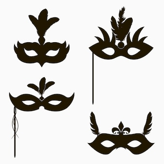 Icônes de masques de carnaval ensemble de décoration de silhouette isolée pour la fête de mascarade avec des plumes