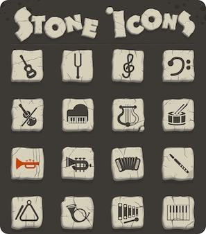 Icônes web d'instruments classiques sur des blocs de pierre dans le style de l'âge de pierre