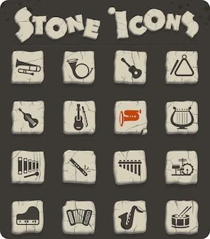 Icônes web d'instruments de musique sur des blocs de pierre dans le style de l'âge de pierre