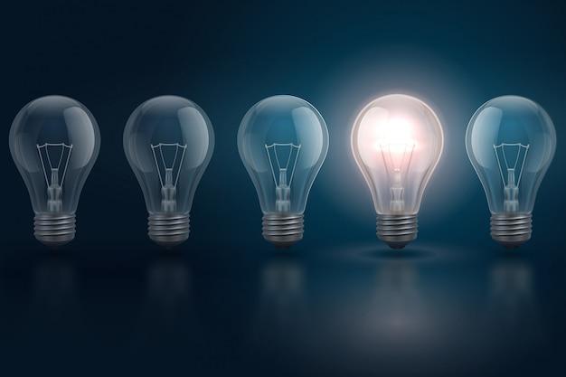 Idée créative avec ampoules et l'une d'elles est éclatante. leadership, individualité