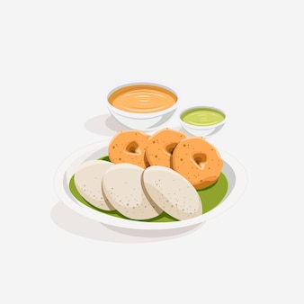 Idli et vada traditionnels du sud de l'inde avec chutney et curry sambar