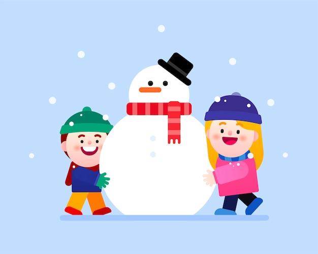Il est temps de construire le bonhomme de neige ensemble en hiver