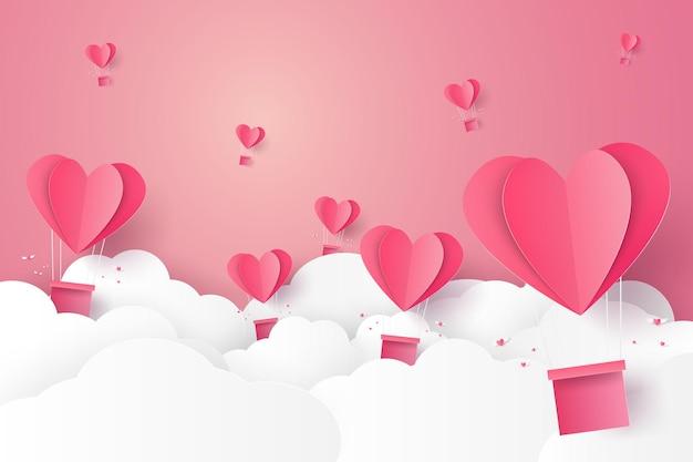 Illustration de l'amour avec une montgolfière coeur rose volant dans le ciel dans un style art papier