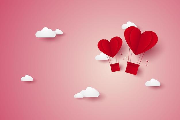 Illustration de l'amour avec une montgolfière coeur rouge volant dans le ciel dans un style art papier