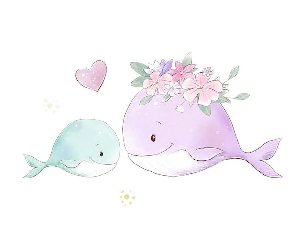 Illustration aquarelle de baleines maman et bébé avec des fleurs délicates