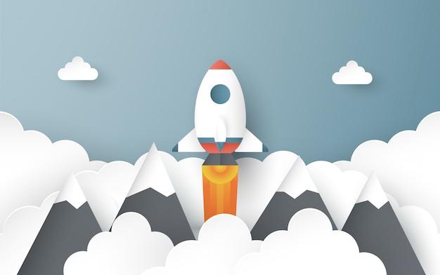 Illustration avec concept de démarrage dans le style de papier découpé, artisanat et origami. la fusée vole sur le ciel bleu.
