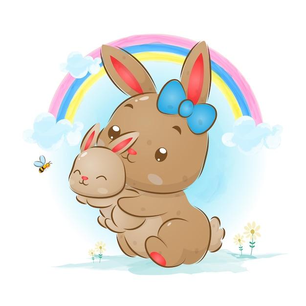Illustration du gros lapin tenant le petit lapin