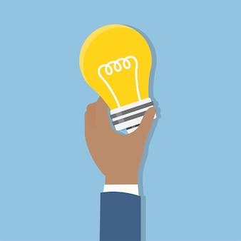 Illustration de la main tenant l'ampoule
