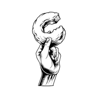 Illustration de la main tenant l'icône de beignet mordu