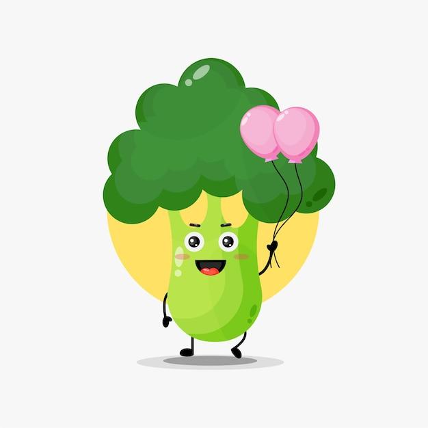 Illustration d'un mignon personnage de brocoli portant un ballon