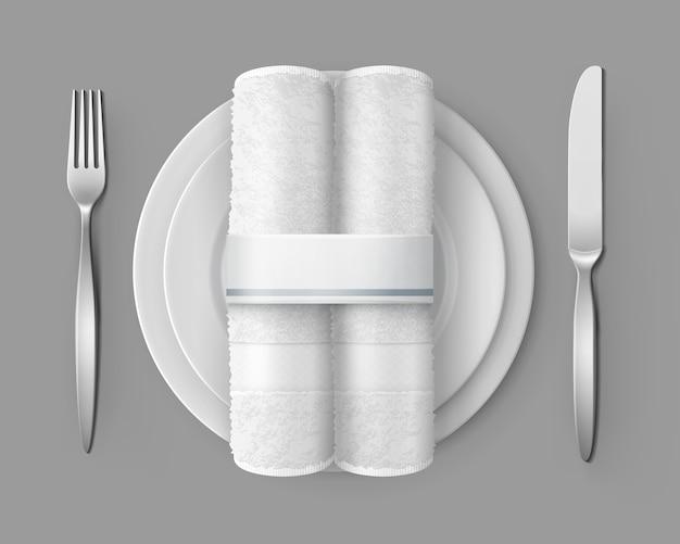 Illustration de la mise en table vue de dessus de deux serviettes en tissu blanc