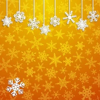 Illustration de noël avec des flocons de neige suspendus blancs sur fond doré